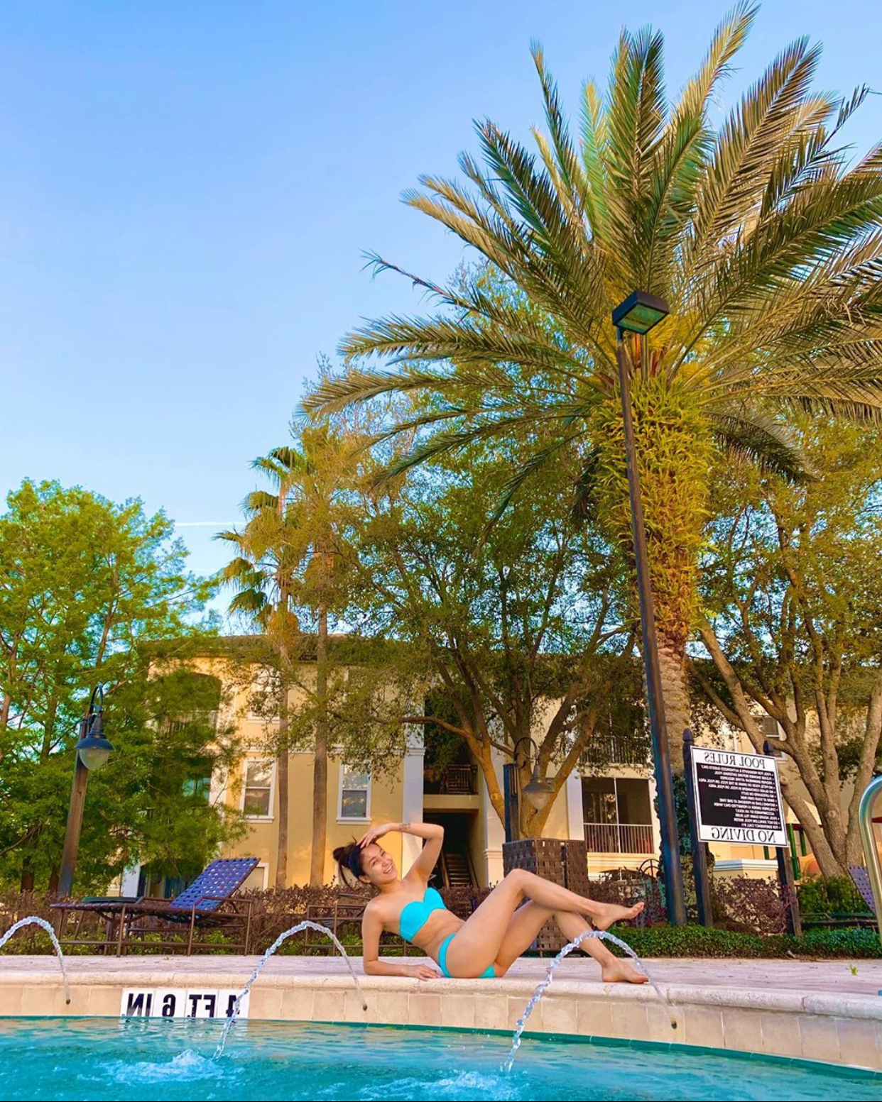 Woman sunbathing at an apartment complex in Orlando, Florida.